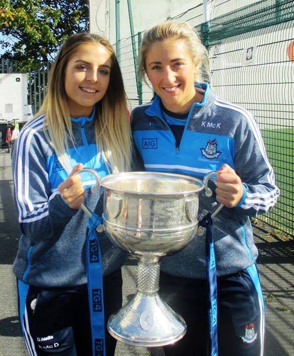 Dublin Senior football players Rebecca McDonnell & Kate McKenna with Brendan Martin cup